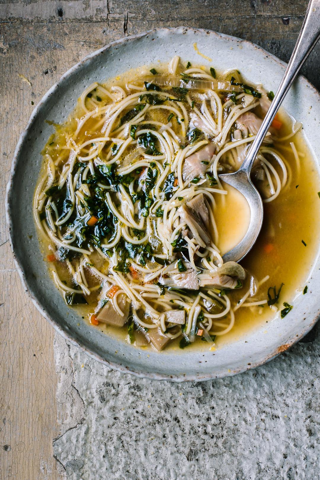 A close up of vegan chicken noodle soup