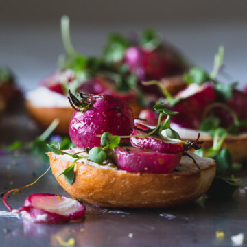A close up of a plate of bagels with roast radish