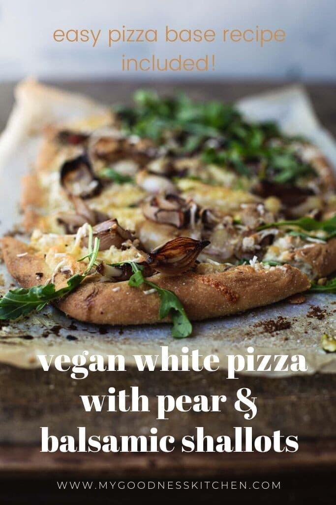Close up image of a vegan pizza on a rustic wooden bench with white title text overlay.