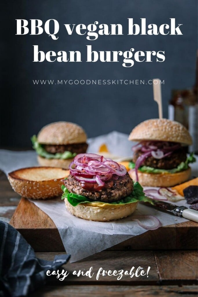 A close up of three black bean burgers sitting on top of a table