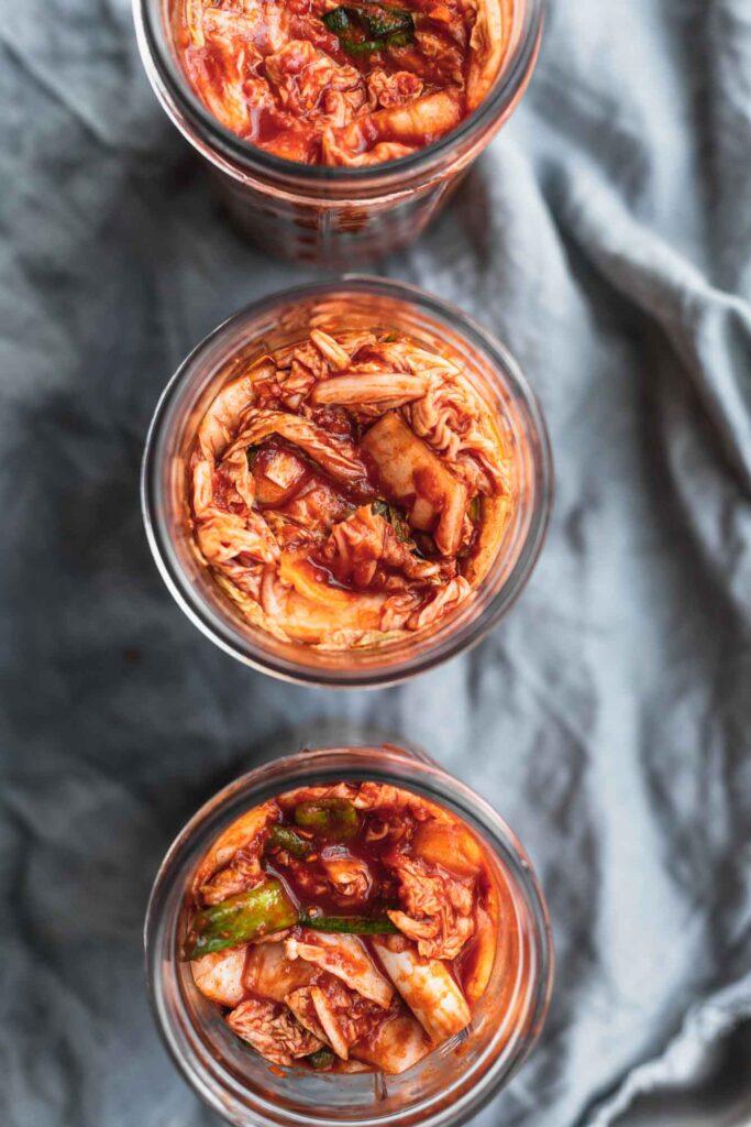 Overhead image of jars of kimchi