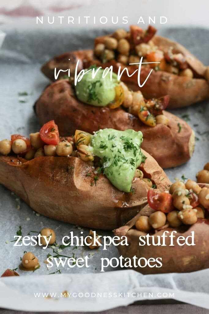 Close up image of freshly three prepared chickpea stuffed sweet potatoes on a lined baking tray with the recipe title overlaid.