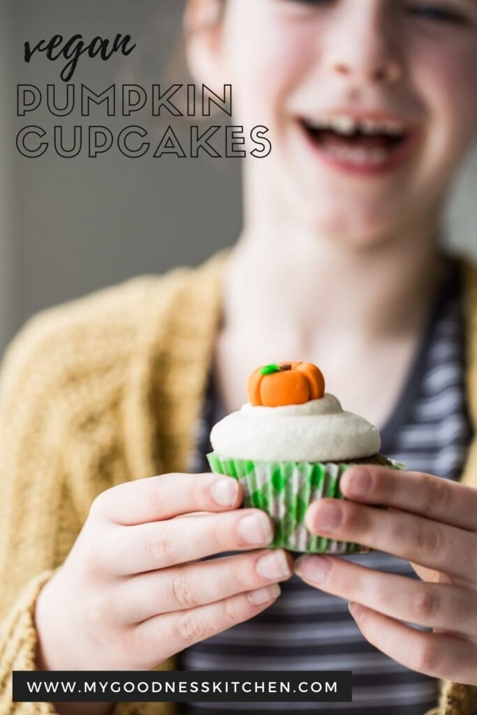 A little girl holding a cupcake laughing with text