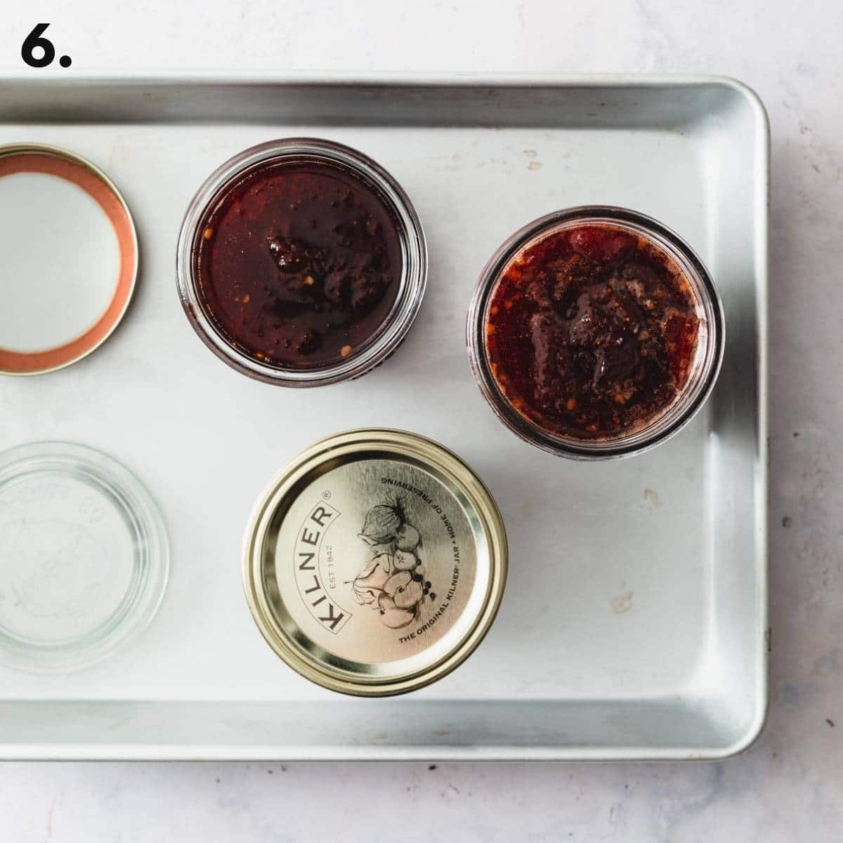 A tray with jars of jam laid out.