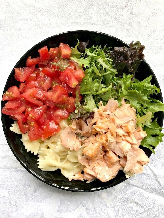 Overhead shoot of a black bowl of pasta salad