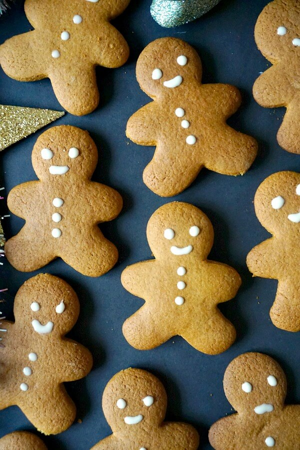 Gingerbread man cookies decorated with melted white chocolate
