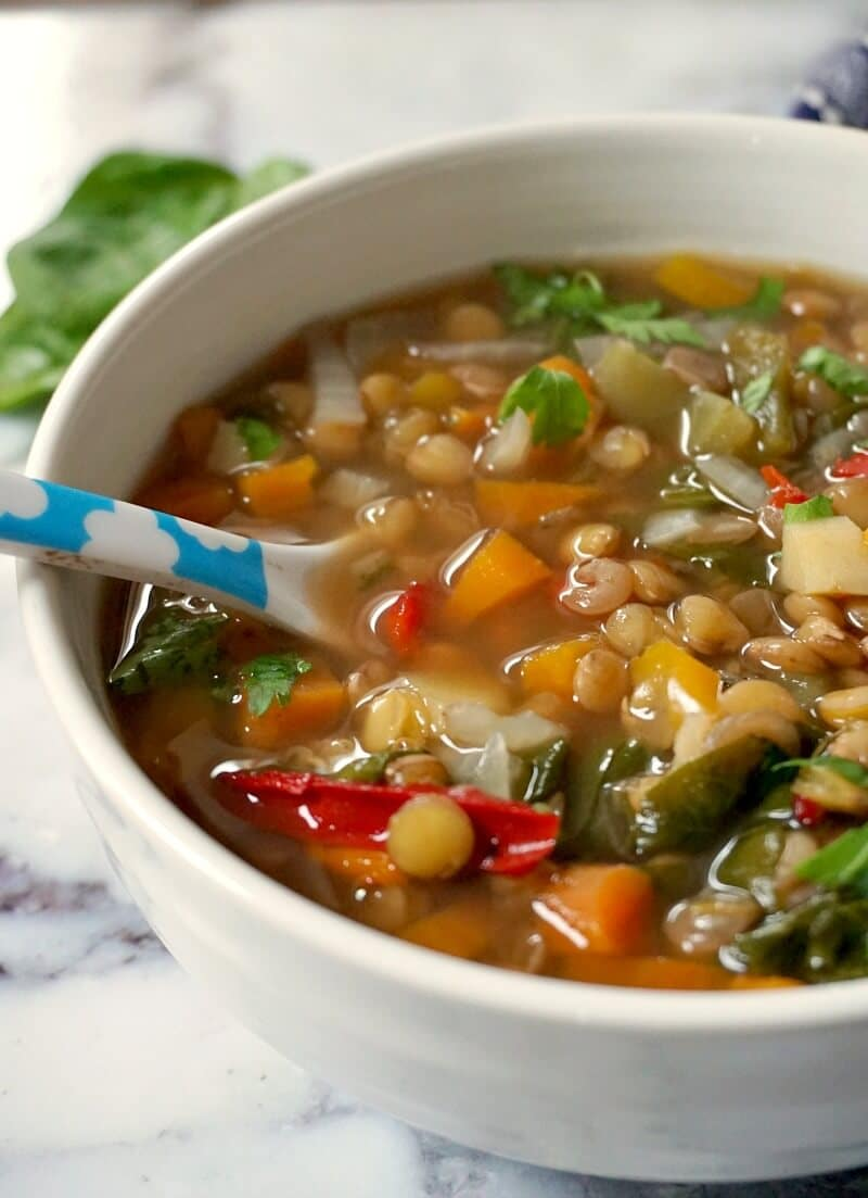 A white bowl of vegan slow cooker lentil soup