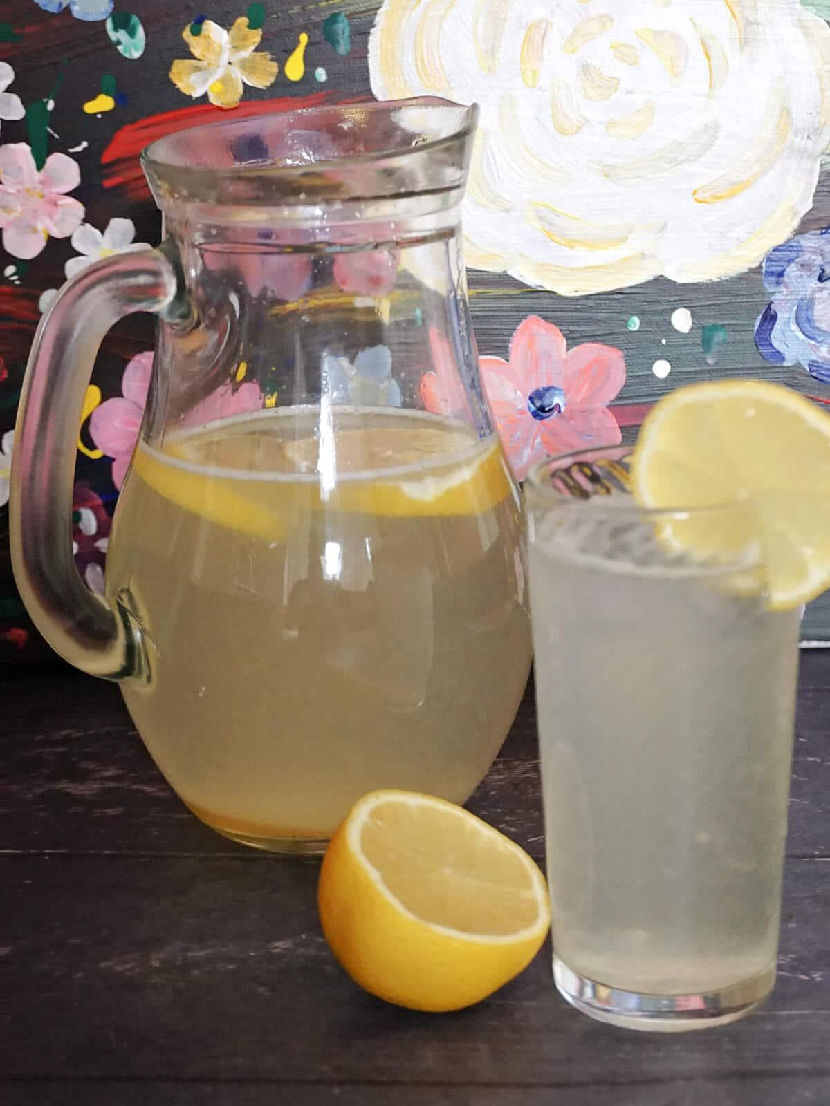 A jug and a glass of lemonade