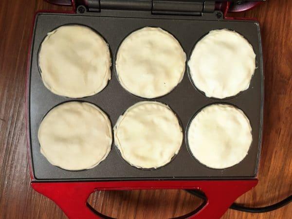 6 mini mushroom pies in a pie maker