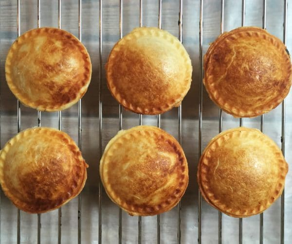 6 mini mushroom pies on a cooling rack