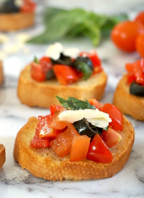 2 tomato bruschetta on a white tablecloth