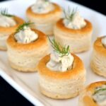 A white plate of 8 smoked salmon pate appetizers