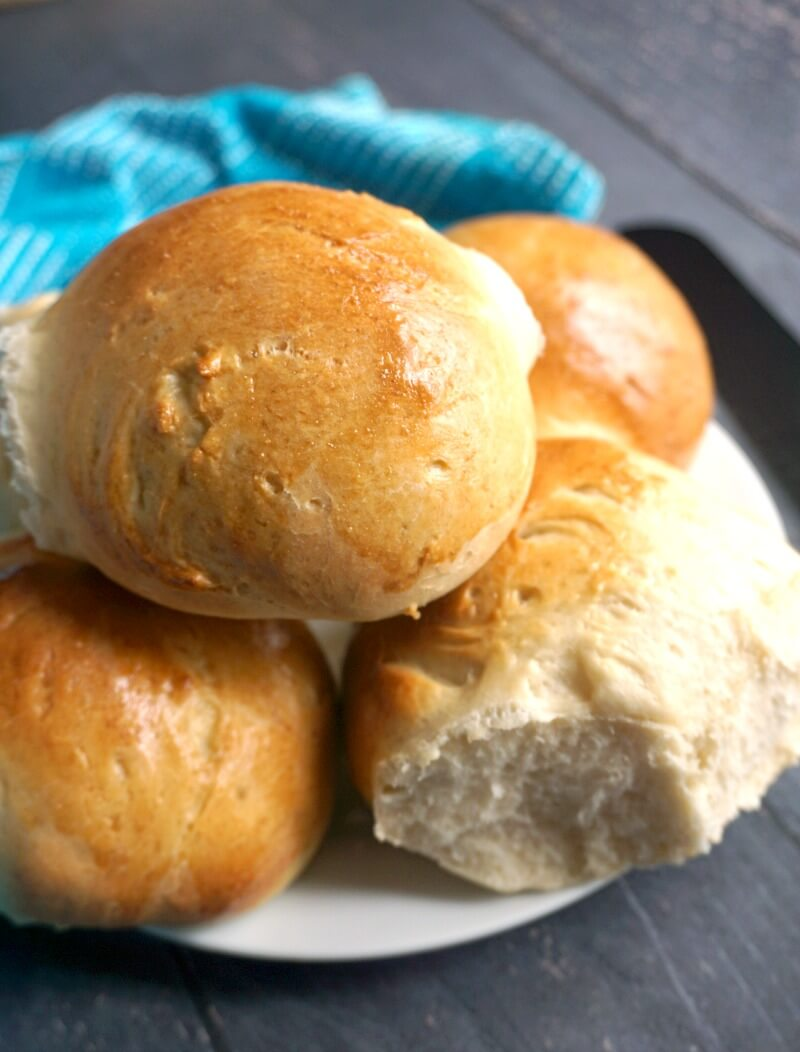 A plate with 5 dinner rolls