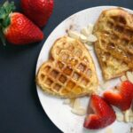 Overehead shoot of a white plate with 2 french toast waffles