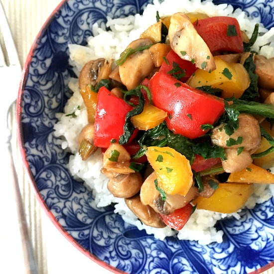 Overhead shot of a blue bowl of mushroom stir fry with rice