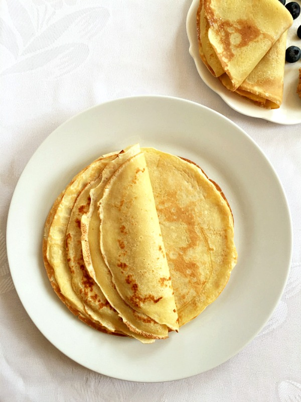 Overhead shoot of a white plate with french crepes