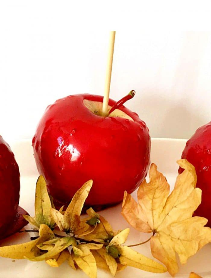 3 red candy apples with skewers in