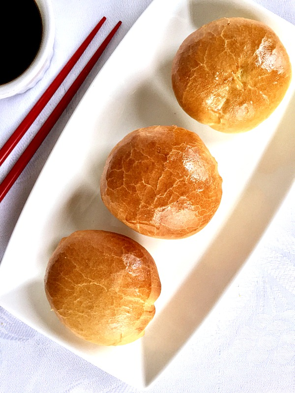 Overhead shoot of a white rectangle plate with baked chinese buns