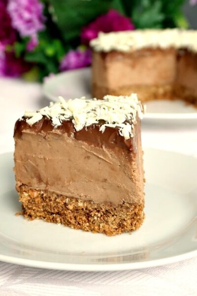 A slice of Triple Chocolate Mascarpone Cheesecake on a white plate