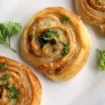 3 Ham and Cheese Pinwheels on a white plate