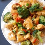 Overhead shoot of a white plate with Chinese Chicken and Broccoli Stir Fry with Rice