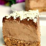 No-Bake Triple Chocolate Mascarpone Cheesecake, a rich and overly-indulgent dessert that screams perfection. The sweetest treat for any party or celebration, this cheesecake is super easy to make and so delicious. It has one layer of digestive biscuits and cocoa powder, another layer of a velvety milk chocolate and mascarpone cream, then topped with dark chocolate and grated white chocolate. The best homemade dessert! #triplechocolatecheesecake, #cheesecake, #mascarpone, #dessert, #npbakedessert