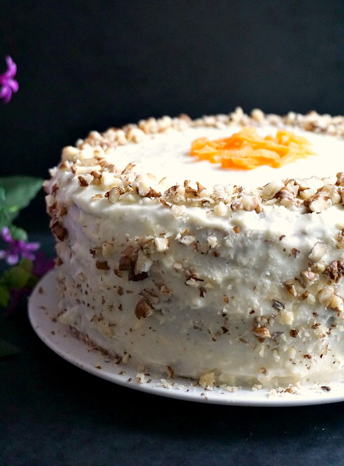A carrot cake decorated with icing