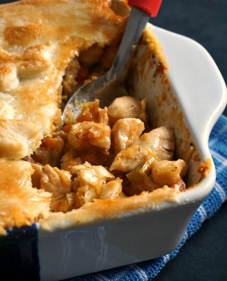 A dish of homemade chicken pot pie with a spoon in it