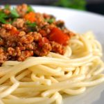 A plate with spaghetti and turkey bolognese sauce