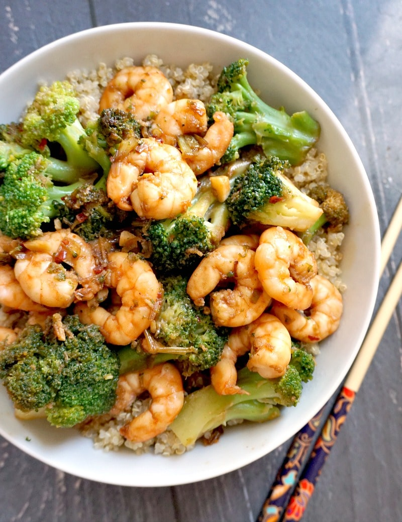 Overhead shoot of a white bowl with shrimp and broccoli