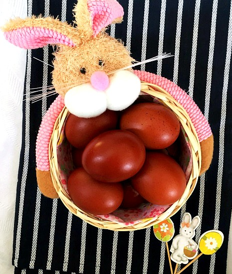 A bunny basket of naturally-dyed Easter eggs