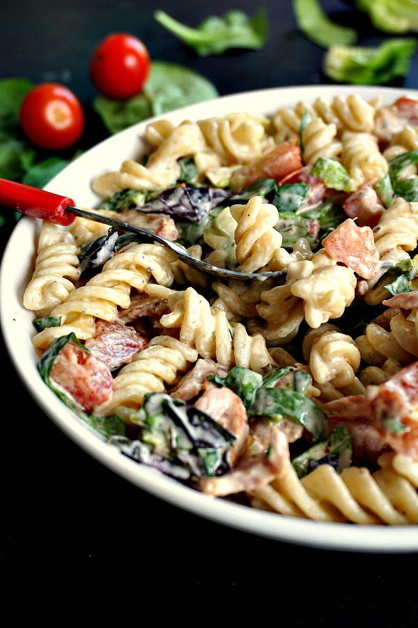 A white plate with BLT pasta salad