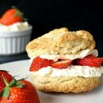 A straberry shortcake filled with cream and sliced strawberries