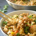 Healthy Chinese Chicken Egg Fried Rice Recipe, a quick, easy and tasty way of using up leftover rice. A delicious dinner can be ready in 15 minutes, and what a dinner! No need for take-away tonight, we've got Chinese at home. It might be a simple recipe, but it certainly is full of amazing flavours. A healthy Chinese recipe that is nutritious, and delicious, plus it goes well with kids too, since there is nothing spicy in there. #eggfriedrice, #chickeneggfriedrice, #chinesefood, #healthyrecipes