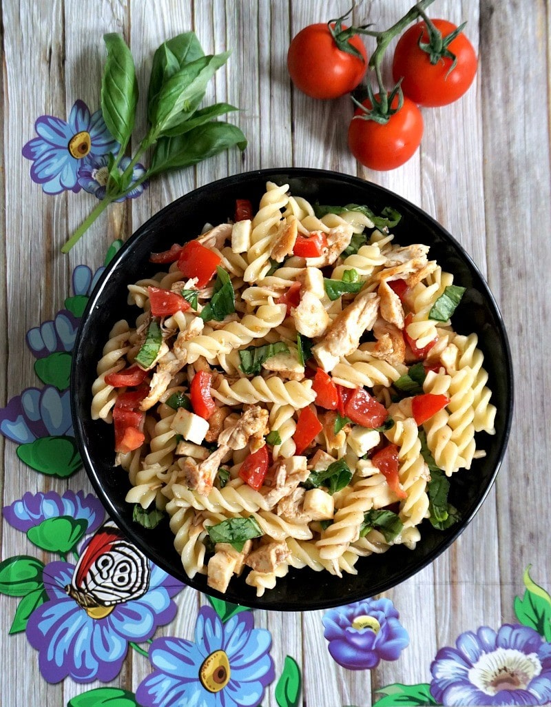 Overhead shoot of a black plate with pasta salad
