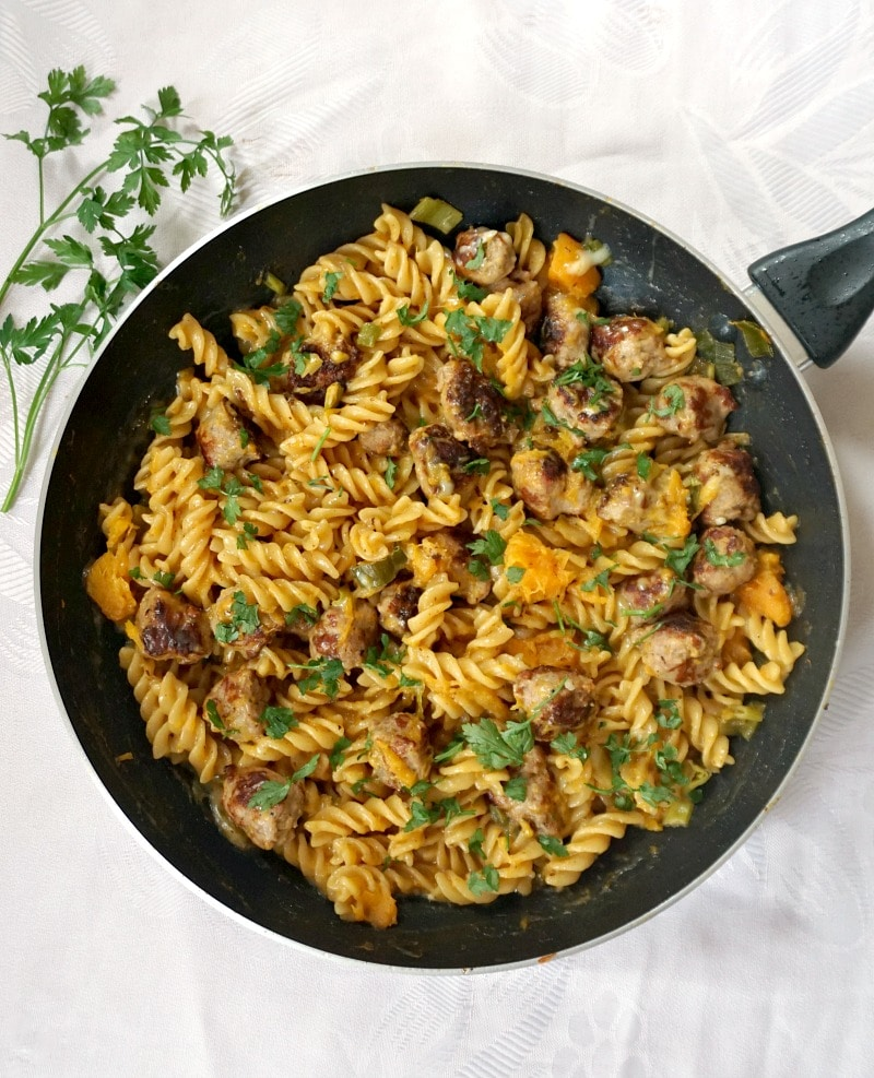 Overhead shoot of a pan with butternut squash and sausage pasta