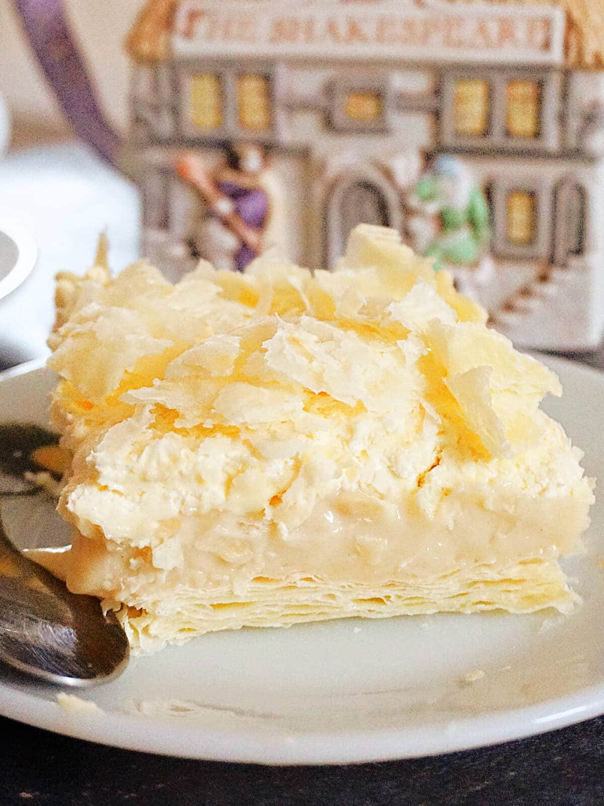 A slice of cremeschnitte on a white plate