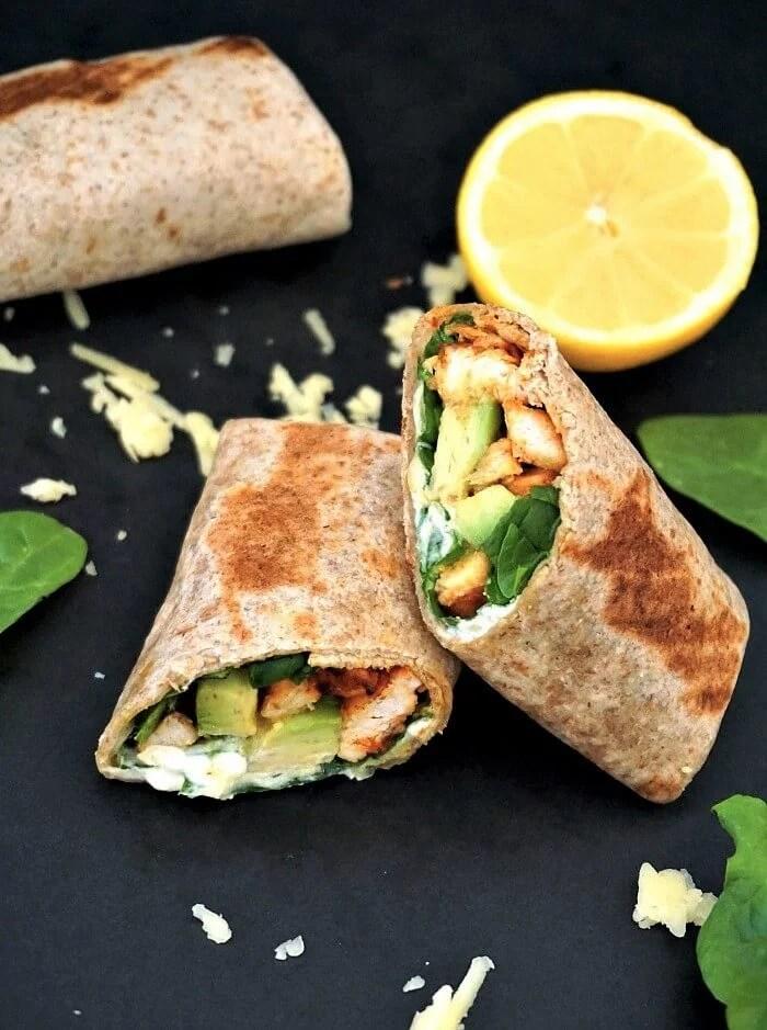 2 halves of a chicken and avocado wrap