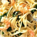 Pasta with Shrimp (Prawn) and Spinach, and a tad of parmesan, a quick dish that is ready in under 30 minutes, ideal for a midweek dinner when time is ever so precious. Flavourful, and so garlicky, with just a hint of lemon, this homemade pasta recipe is simple, but absolutely delicious. The prawns are cooked with garlic and ginger for a nice kick, then the pasta is tossed with the spinach and prawns, and served with parmesan cheese. Quick, easy and so healthy. #prawns, #shrimp, #pasta, #dinner
