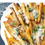 Baked parsnip fries or parsnip chips, a great side dish alternative to the good old roast potatoes for your Thanksgiving or Christmas dinner or any other occasion. With a nice blend of paprika, parmesan, parsley, garlic powder, salt and pepper, plus a dash of olive oil, these parsnip fries are simply delicious.