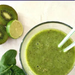 Overhead shoot of a glass of kiwi spinach smoothie