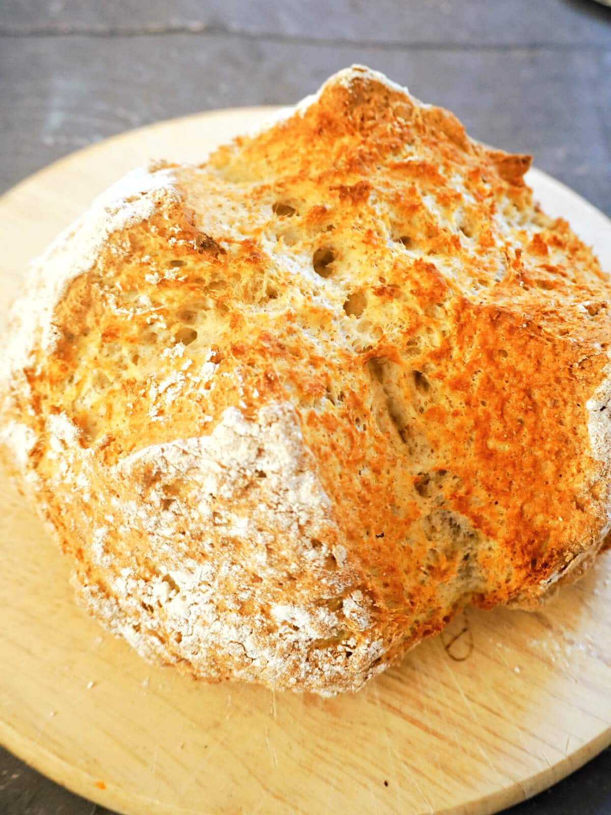 Close-up shot of a soda bread on a wooden board