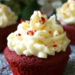 Perfectly moist Red Velvet Cupcakes topped with a rich vanilla buttercream, the best homemade cupcakes made from scratch. This is such a simple recipe, and the cupcakes can be enjoyed either for Christmas or Valentine's Day, or, why not, all year round. Learn how to make the best vanilla buttercream every single time, and enjoy some easy, but so delicious red velvet cupcakes for any celebration. #redvelvetcupcakes, #vanillabuttercream, #cupcakes, #dessert, #christmasdessert, #icing