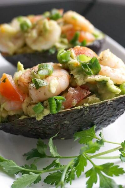 2 avocado skins stuffed with avocado shrimp salad