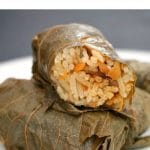 Vegetarian stuffed grape leaves with mushrooms and rice, or Dolmades, a delicious meal for the whole family. Learn how to roll the grape leaves like a pro and cook a superb dinner so easily with this simple recipe. Only 47 calories per roll.