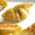 Pan-Fried Dumplings, or Chinese Potstickers made with wonton wrappers and a filling of shrimp/prawn and pork, and a kick of garlic, spring onions and ginger. They are the best dim sums/appetizers for every party, and can be ready in about 15-20 minutes. Why not try them this Chinese New Year? Quick and easy to make, and healthy too, these dumplings are the best of the Chinese cuisine. They can be steamed in any pan with a lid you have. #chinesenewyear, #chinesedumplings, #potstickers, #partyfood