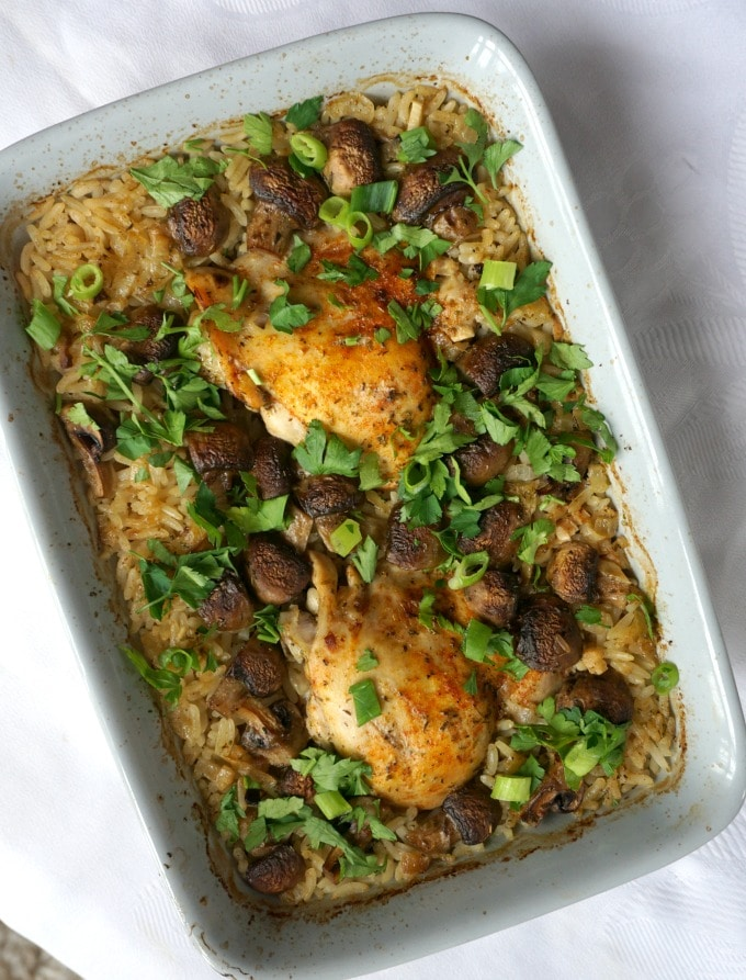 Overhead shoot of an oven casserole of baked chicken with rice and mushrooms
