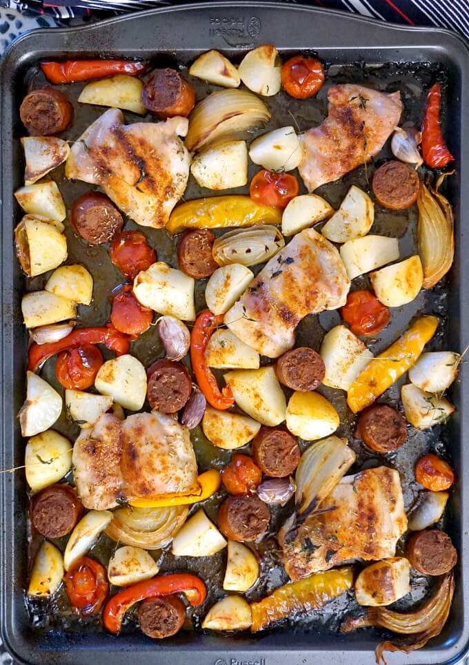 Overhead shoot of a sheet pan with vegetables, chicken with chorizo