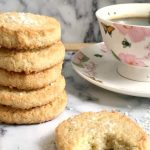 Coconut Shortbread Cookies, a quick fix when you feel like snacking, and your sweet tooth is craving something yummy. Soft, almost melting in your mouth, buttery, full of coconut flavour, these cookies are absolutely delicious! My coconut shortbread cookies are made with a few simple ingredients, and are easy to make. If you like the classic shortbreads, you will love these yummy cookies. Buttery, rich, perfect with a hot drink. #coconutshortbreadcookies, #shortbreadcookies, #cookies, #dessert
