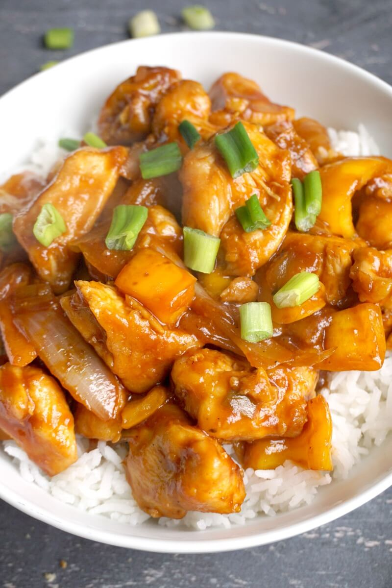 Close-up shoot of sweet and sour chicken over a bed of rice